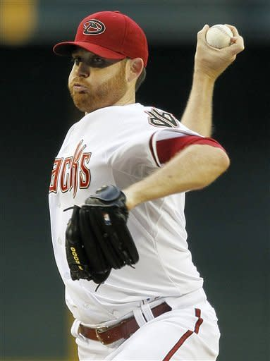 Arizona Diamondbacks pitcher Ian Kennedy winds up against the St. Louis Cardinals during the first inning of a baseball game Tuesday, May 8, 2012, in Phoenix. (AP Photo/Matt York)