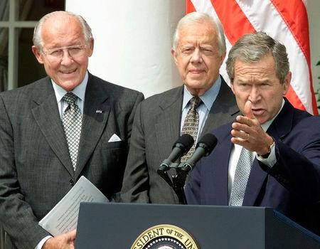 U.S. President George W. Bush speaks while receiving the Report of the National Commission on Federal Election Reform from former President Jimmy Carter and former House Minority Leader Bob Michel while in the Rose Garden of the White House in Washington
