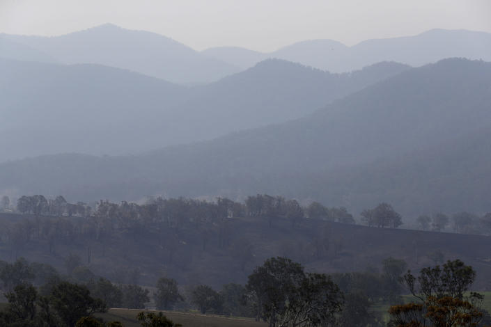 Smoke hangs in layers in the mountains near Bemboka Friday, Jan. 10, 2020. Thousands of people are fleeing their homes and helicopters are dropping supplies to towns at risk of wildfires as hot, windy conditions threaten already fire-ravaged southeastern Australian communities. The danger is centered on Australia's most populous states, including coastal towns that lost homes in earlier fires. (AP Photo/Rick Rycroft)