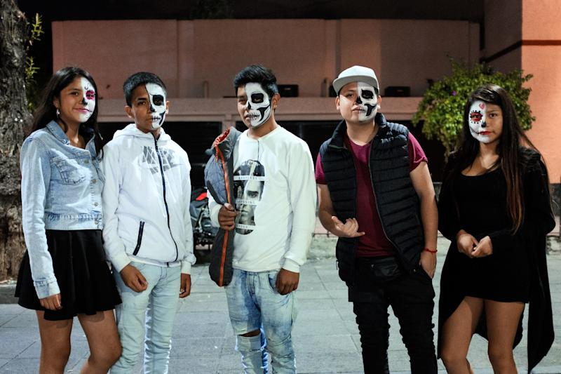 Xochimilco youth, with their faces painted as Catrines.