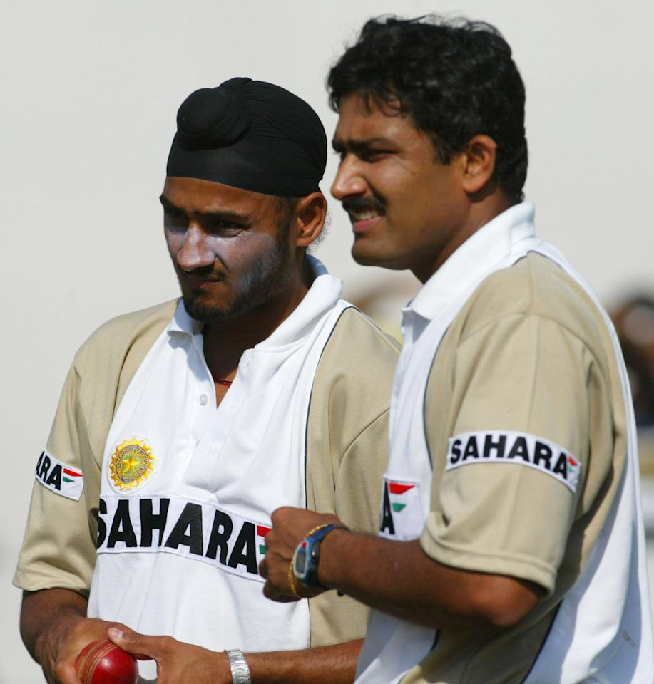 10 Dec 2001:  Harbhajan Singh and Anil Kumble of India during net practice ahead of the Second Test match against England at the Sardar Patel Gujarat Stadium in Ahmedabad, India. DIGITAL IMAGE Mandatory Credit: Laurence Griffiths/ALLSPORT