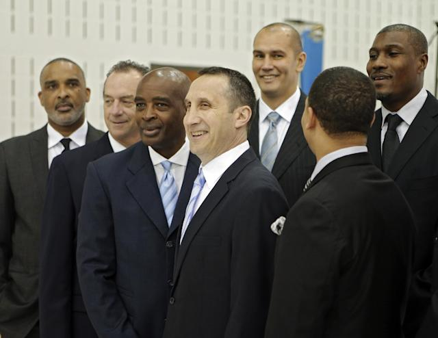 Cleveland Cavaliers head coach David Blatt, center, poses with his assistant coaches at the NBA basketball team's practice facility in Independence, Ohio Friday, Sept. 26, 2014. (AP Photo/Mark Duncan)