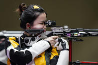 Yang Qian, of China, competes in the women's 10-meter air rifle at the Asaka Shooting Range in the 2020 Summer Olympics, Saturday, July 24, 2021, in Tokyo, Japan. (AP Photo/Alex Brandon)