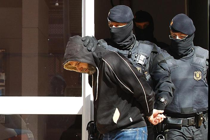 A man suspected of links to Islamic State groups is arrested during a police operation in Sabadell, in Spain's Catalonia region, on April 8, 2015 (AFP Photo/Quique Garcia)