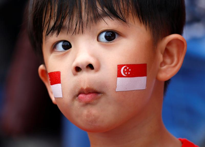 A young boy, face painted with national flag is seen during Singapore's 54th National Day Parade in Singapore August 9, 2019. REUTERS/Feline Lim