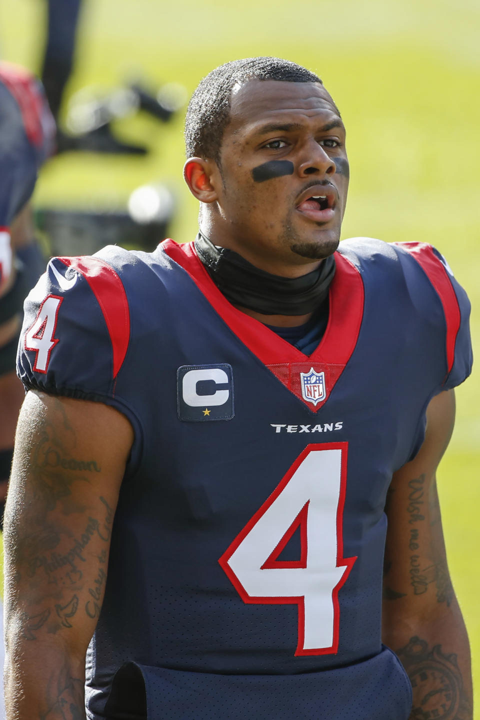 FILE- In this Dec. 13, 2020, file photo, Houston Texans quarterback Deshaun Watson walks off the field after warm ups before an NFL football game against the Chicago Bears in Chicago. On Friday, April 9, 2021, a judge has ordered that the name of one of the 22 women who have filed lawsuits accusing Watson of sexual assault and harassment must be made public. (AP Photo/Kamil Krzaczynski)