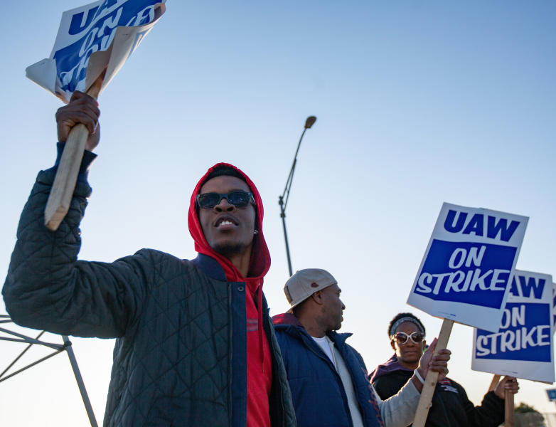 Motorline worker Ray Gladney of Florrisant, materials worker Brookes Robinson of Central West End, and Trim Doorline Worker Danielle Harris of Richmond Heights, picket at the General Motors plant in Wentzville, Mo., on Tuesday, Oct. 22, 2019. United Auto Workers around the country will be voting on whether to accept or deny the recent offer made to the union by GM in the coming week. (Troy Stolt/St. Louis Post-Dispatch via AP)