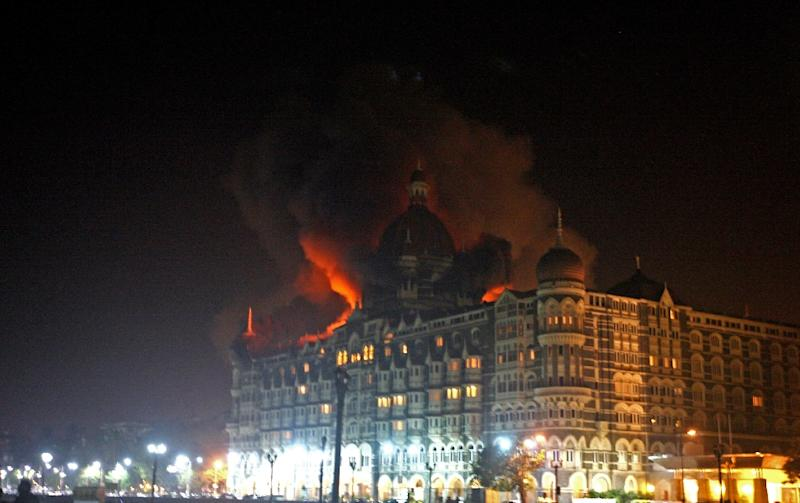 A fire breaks out in the dome of the Taj Mahal Hotel in Mumbai on November 26, 2008, during an attack, blamed on banned Pakistani militant group Lashkar-e-Taiba, that killed 166 (AFP Photo/Pal Pillai)