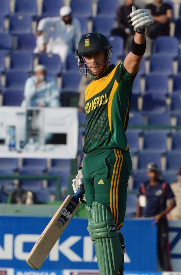 South African batsman Faf du Plessis celebrates after making fifty runs during the third day-night international in Sheikh Zayed Cricket Stadium in Abu Dhabi on Novemver 6, 2013. South African captain AB de Villiers won the toss and decided to bat in the first. The five-match series is tied at 1-1. AFP PHOTO/ Asif HASSAN        (Photo credit should read ASIF HASSAN/AFP/Getty Images)