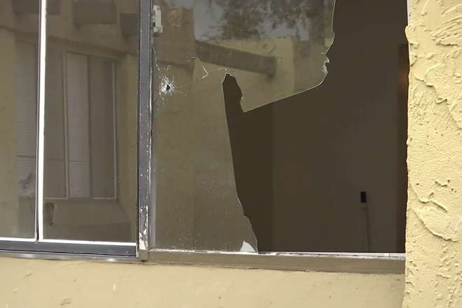 Bullet holes can be seen in the walls and windows of the teen's Jacksonville apartment.
