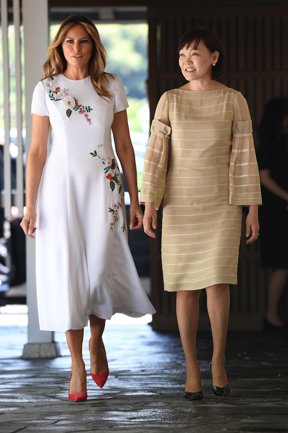 Melania Trump made sure to dress diplomatically for the day in a £5,847 Carolina Herrera dress finished with punchy heels. [Photo: Getty]