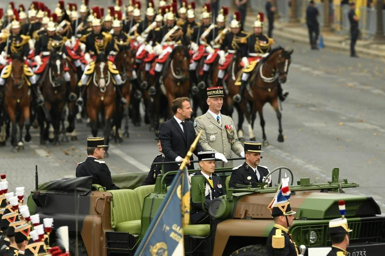 France's President Emmanuel Macron at the head of the Bastille Day parade in central Paris stressed European defence cooperation (AFP Photo/Lionel BONAVENTURE)