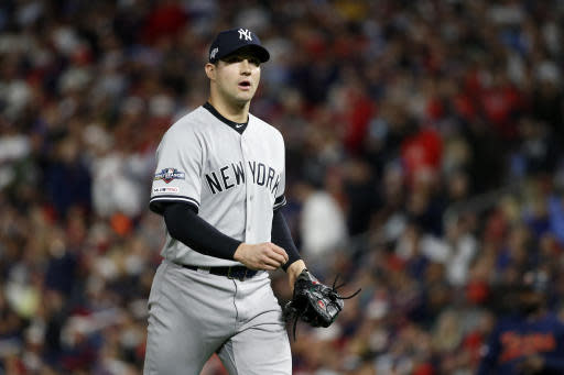 New York Yankees relief pitcher Tommy Kahnle walks to the dugout after being taken out during the fifth inning in Game 3 of a baseball American League Division Series against the Minnesota Twins, Monday, Oct. 7, 2019, in Minneapolis. (AP Photo/Bruce Kluckhohn)