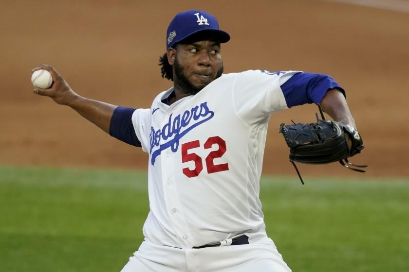 Los Angeles Dodgers relief pitcher Pedro Baez throws against the Atlanta Braves.