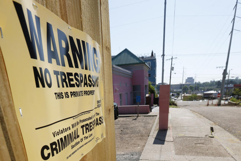 "A ""No Trespassing"" sign is posted along the fencing protecting the parking lot of the Jackson Women's Health Organization, Friday, May 17, 2019, in Jackson, Miss. The facility is the state's only abortion clinic. (AP Photo/Rogelio V. Solis)"