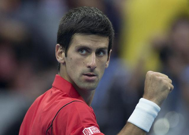 Novak Djokovic of Serbia rects after defeating Fernando Verdasco of Spain during the China Open tennis tournament at the National Tennis Stadium in Beijing, China Thursday, Oct. 3, 2013. (AP Photo/Andy Wong)