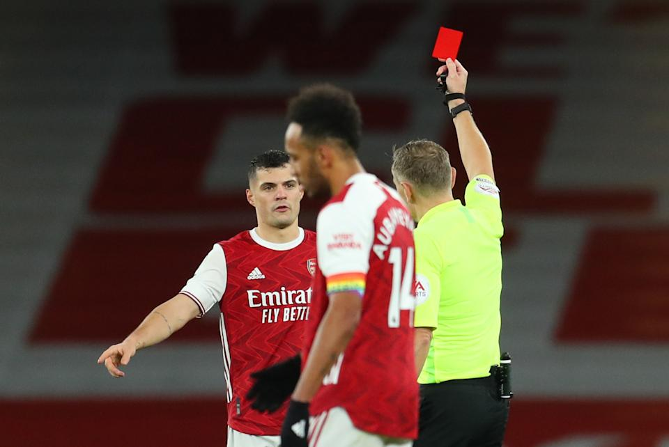 Arsenal's Granit Xhaka is shown a red card by referee Graham Scott as teammate Pierre-Emerick Aubameyang looks on