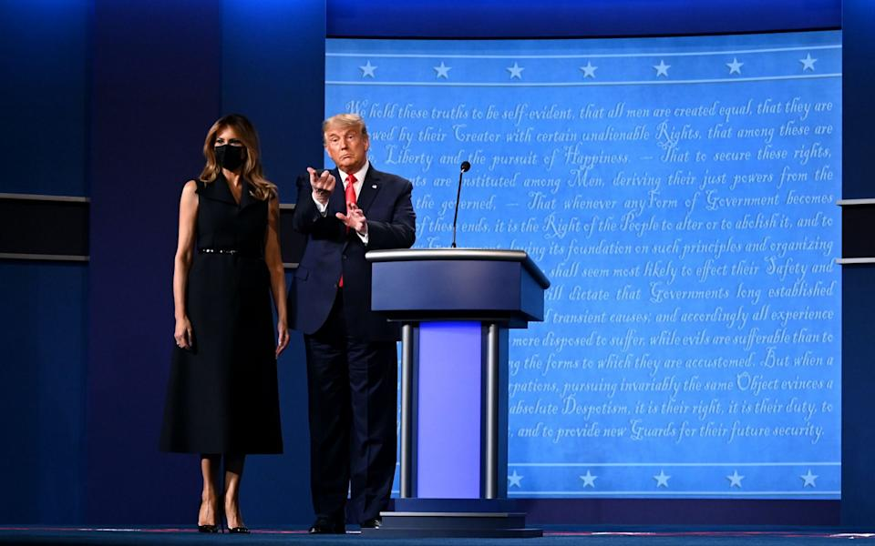 Melania and Donald Trump on stage - AFP