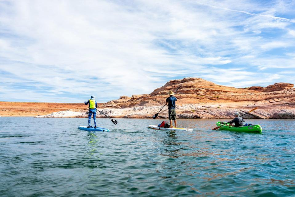 """<p>It's not often that mankind creates something of such extraordinary natural beauty, but that's <a href=""""https://www.lakepowell.com/"""" rel=""""nofollow noopener"""" target=""""_blank"""" data-ylk=""""slk:Lake Powell"""" class=""""link rapid-noclick-resp"""">Lake Powell</a>. This man-made lake's warm blue waters wind through red sandstone cliffs, filling more than 90 side canyons. Nearby, take view of one such canyon with the sandstone Rainbow Bridge, regarded as the world's longest natural arch.</p>"""
