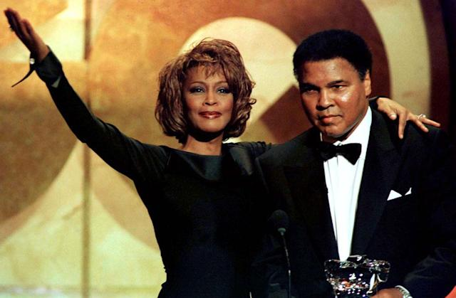 Former boxing great Muhammad Ali is given the Courage Award by singer Whitney Houston at the GQ Men of the Year awards show October 21 in New York. Ali was among a group of 16 men of distinction selected by the readers of GQ magazine.