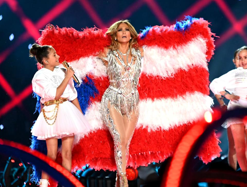 Jennifer Lopez wears a cape of feathers that doubled as a flag during the Super Bowl halftime show Sunday at Hard Rock Stadium in Miami. (Photo: Kevin Mazur/WireImage)