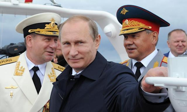"""<span class=""""element-image__caption"""">Vladimir Putin attends naval celebrations in Kaliningrad, which also serves as a base for Russia's Baltic fleet. </span> <span class=""""element-image__credit"""">Photograph: Mikhail Klimentyev/AFP/Getty Images</span>"""