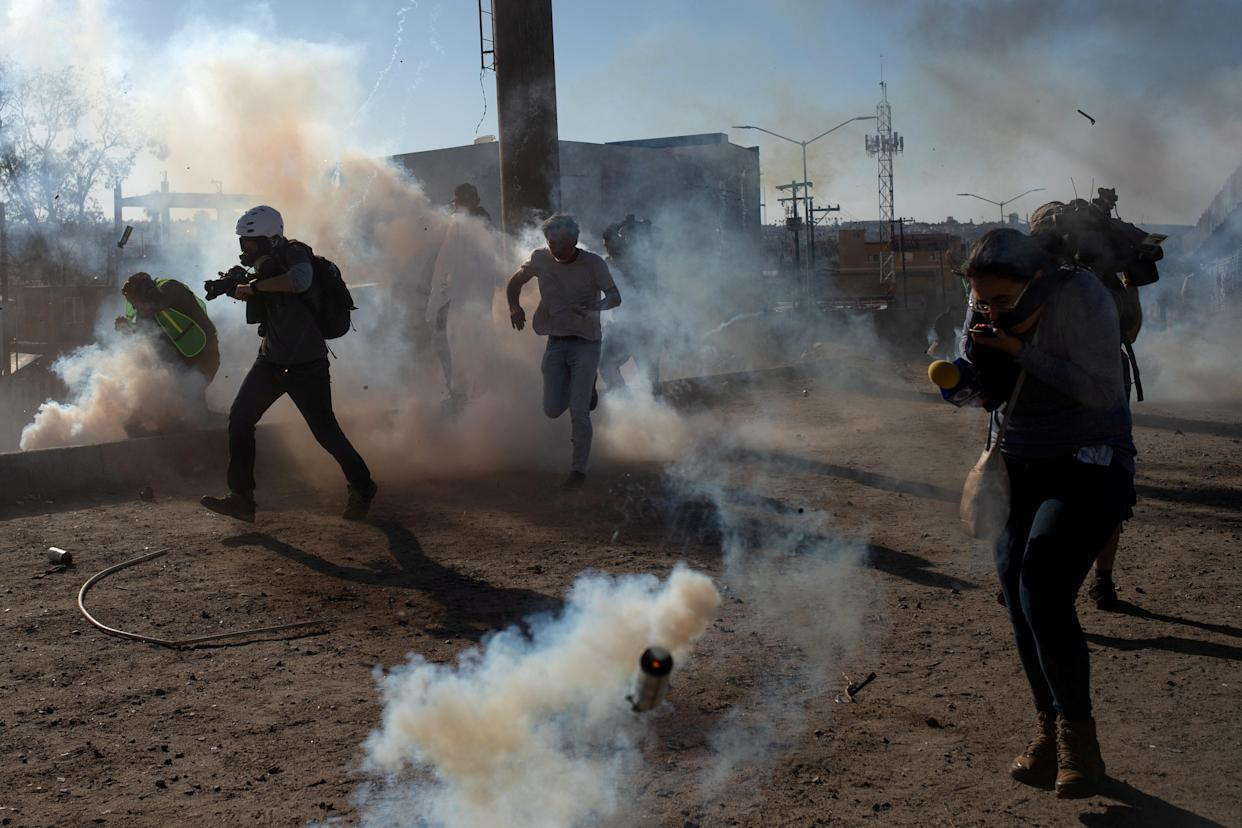 Migrants from Central America and journalists are hit by tear gas after hundreds tried to illegally cross the Mexico border into the United States in Tijuana, Mexico November 25, 2018. (Photo: Adrees Latif/Reuters)