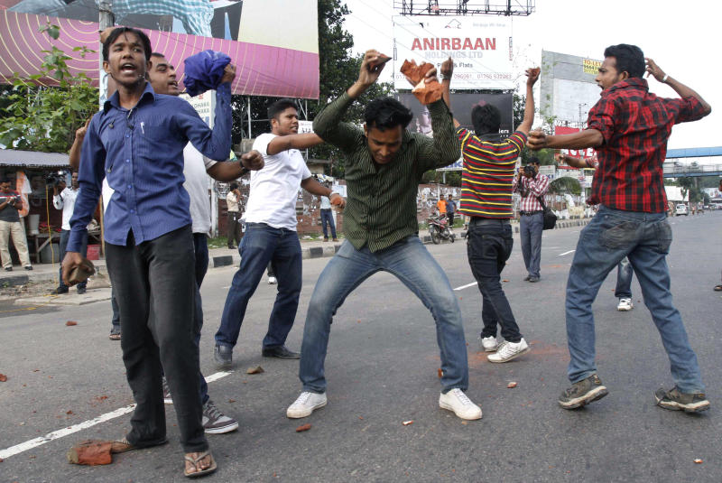 FILE - In this April 29, 2012 file photo, Bangladeshi opposition activists shout slogans before throwing stones at vehicles during a nationwide general strike against the abduction of opposition politician Elias Ali in Dhaka, Bangladesh. The abduction of Ali and his driver as they returned home from meeting supporters at a hotel on April 17, 2012, has sparked one of Bangladesh's biggest crisis in years. The clashes have reignited hostilities between Prime Minister Sheikh Hasina and her archrival Khaleda Zia, who have alternated in power since a pro-democracy movement ousted the last military regime in 1990. (AP Photo/Pavel Rahman, File)