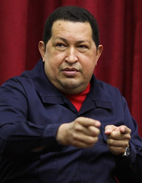 """In this photo released by Miraflores Press Office, Venezuela's President Hugo Chavez speaks during a televised program from the Miraflores presidential palace in Caracas, Venezuela, Wednesday April 11, 2012. Chavez returned to Venezuela Wednesday night and said he's """"doing well"""" following cancer treatment in Cuba. Chavez flew to Cuba last week for his third round of radiation therapy. (AP Photo/Miraflores Presidential Office)"""