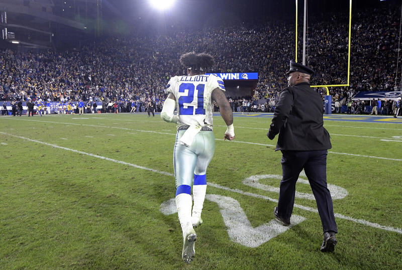 Dallas Cowboys running back Ezekiel Elliott (21) runs off the field after a 30-22 loss against the Los Angeles Rams in the NFL Divisional Round at the Los Angeles Memorial Coliseum on Saturday, Jan. 12, 2019. (Max Faulkner/Fort Worth Star-Telegram/TNS via Getty Images)
