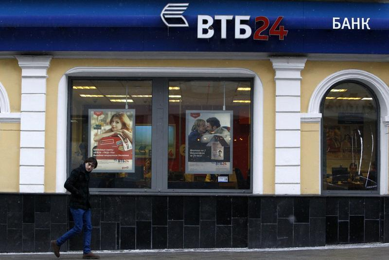 A man passes by an office of VTB Bank in central Moscow