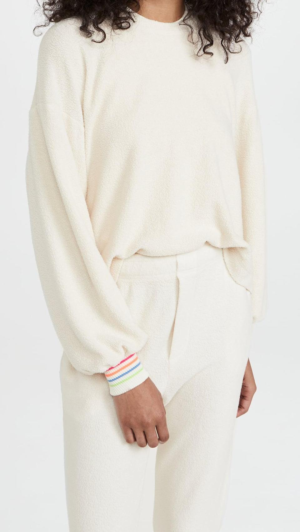 <p>This <span>Sundry Stripe Cuff Faux Sherpa Sweatshirt</span> ($148) looks like a classic cream crewneck, but the cuffs tell a different story. We're obsessed with the rainbow.</p>