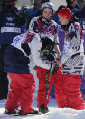 Men's ski slopestyle gold medal winner Joss Christensen of the United States, left, celebrates with his teammates Gus Kenworthy, right, silver, and Nicholas Goepper, bronze, center, at the end of Christensen's last run, at the Rosa Khutor Extreme Park, at the 2014 Winter Olympics, Thursday, Feb. 13, 2014, in Krasnaya Polyana, Russia. (AP Photo/Andy Wong)