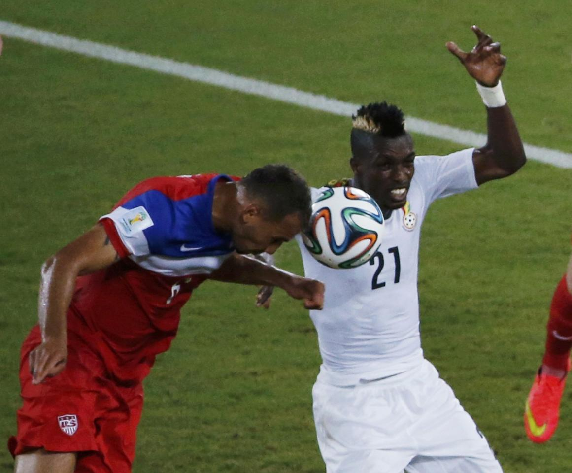 John Brooks of the U.S. (L) heads the ball to score a goal next to Ghana's John Boye during their 2014 World Cup Group G soccer match against Ghana at the Dunas arena in Natal June 16, 2014. REUTERS/Carlos Barria (BRAZIL - Tags: SOCCER SPORT WORLD CUP) TOPCUP