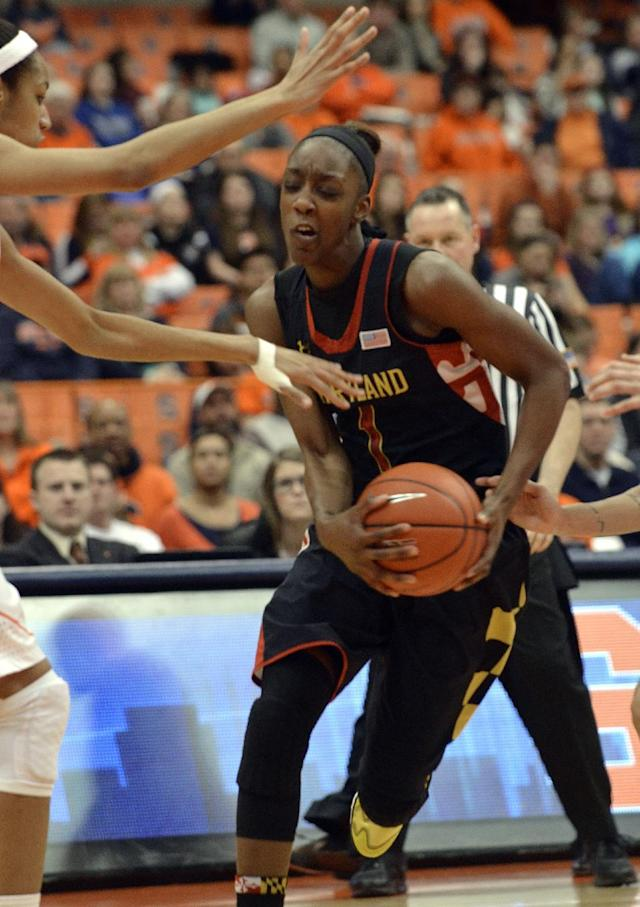 Maryland's Laurin Mincy drives against Syracuse during the first half of an NCAA college basketball game in Syracuse, N.Y., Sunday, Feb. 2, 2014. (AP Photo/Kevin Rivoli)