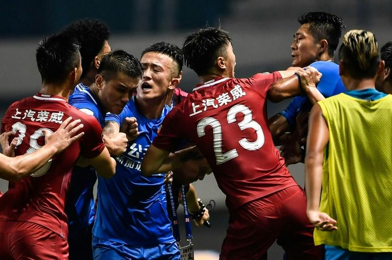 The brawl erupted after Shanghai SIPG playmaker Oscar appeared to fire the ball deliberately at Guangzhou players