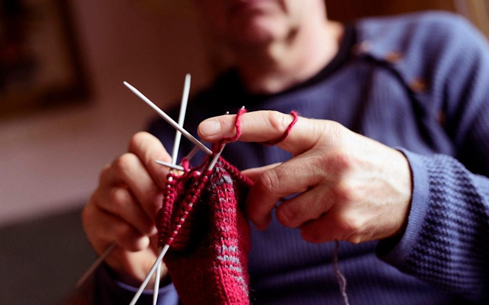 Men are increasingly turning to knitting as a mindfulness exercise - wayra/iStockphoto