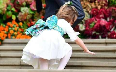 Princess Charlotte stumbles up the steps - Credit: PA