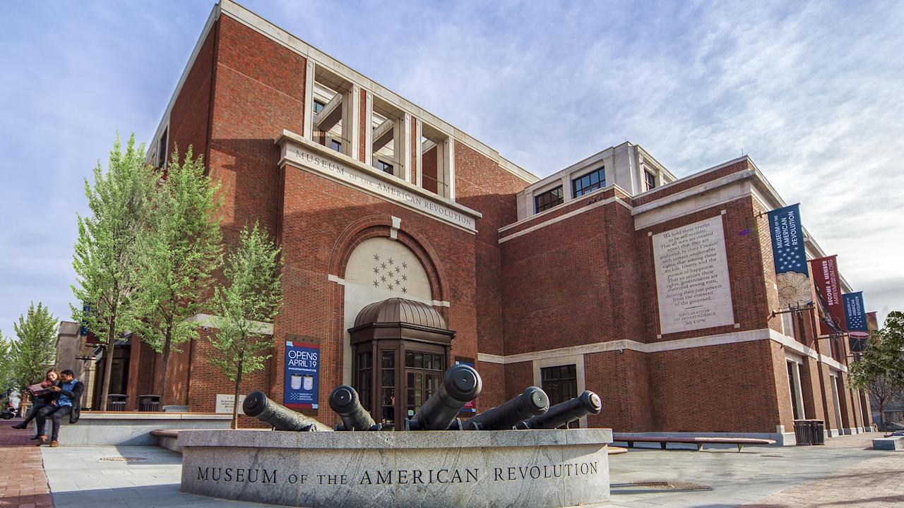 "<p><strong>Tell us about this place.</strong><br> The elegant design of the new Museum of the American Revolution, courtesy of American architect Robert A.M. Stern, echoes that of its Colonial-era neighbors (think red brick, and lots of it) albeit with a light-filled, contemporary feel. Standing sentry on a prime corner lot across from <a href=""https://www.cntraveler.com/activities/philadelphia/independence-national-historic-park?mbid=synd_yahoo_rss"">Independence National Historic Park</a>, it's a must-visit. Just don't expect the same, tired narrative you were taught in elementary school—this museum takes a different track entirely.</p> <p><strong>What's to see once in?</strong><br> You'll start with a short video presentation downstairs, then climb a sweeping staircase up to the galleries where video installations, tableaus, and artifacts weave together the story from pre-Revolutionary rumblings straight on through to the Articles of Confederation. While you'll see plenty of rifles and swords, you'll also hear and see the sounds of the Revolution and learn the stories of the people behind it. It's not all George Washington, all the time, either: Exhibits are honest and raw, eschewing the overwrought, often whitewashed version of events to highlight the overlooked perspectives of Native Americans, African Americans, and women.</p> <p><strong>Are there any temporary exhibits worth checking out?</strong><br> Temporary exhibits mirror the cultural zeitgeist; next up, the role of women voters in Revolutionary times. Still, you really come here for the new narrative as demonstrated in the galleries, as well as a drummed-up presentation of George Washington's <em>actual</em> tent.</p> <p><strong>What is the crowd like?</strong><br> It's a mix of tourists, history buffs, and students on field trips. It's definitely a popular vacation or rainy day destination for families, so avoid school holidays if you want to skip the crowds.</p> <p><strong>How are the facilities?</strong><br> In contrast to the light-filled rotunda, the galleries themselves are a warren of dimly lit, intimate rooms filled with the sights, and often the sounds, of the Revolution. If that grand staircase intimidates, the nearby elevators are a speedy alternative.</p> <p><strong>How about guided tours—do they offer any, and should we take one?</strong><br> The museum offers guided tours for groups, as well as family-focused highlight tours, and audio tours are available for an additional $5. That said, it's possible to glean enough information on your own.</p> <p><strong>And the gift shop? Should we grab anything before we go?</strong><br> The first-floor gift shop is largely filled with kid-friendly quill pens and tricorne hats that make for fun Instagram pics but collect dust at home. Their comprehensive collection of history books, however, will appeal to readers and history lovers.</p> <p><strong>What's the food situation, if there is one?</strong><br> The Cross Keys Café features a hipster take on colonial design, with communal-sized, bare wood tables and cherry-red chairs, and its cool coffee shop vibe makes it an inviting place to settle in for a while. The café is self-serve, with a selection of pre-made sandwiches, salads, and sides, while breakfast sandwiches and flatbreads are made to order at the counter. The food, if you can believe it, is actually pretty great, and it's even a bit Colonial-inspired—think bread pudding, Berkshire ham, and pot pies that hearken to the days of yore.</p> <p><strong>Any last advice for the time- or attention-challenged?</strong><br> You don't need more than an hour to get the gist of the place, but those who want to take a deeper dive will have plenty to look at.</p>"