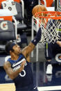 Minnesota Timberwolves' D'Angelo Russell (0) lays up a shot against the Memphis Grizzlies in the second half of an NBA basketball game, Wednesday, Jan. 13, 2021, in Minneapolis. The Grizzlies won 118-107. Russell scored 25 points. (AP Photo/Jim Mone)