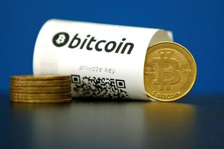 An illustration photo shows a Bitcoin (virtual currency) paper wallet with QR codes and a coin are seen at La Maison du Bitcoin in Paris