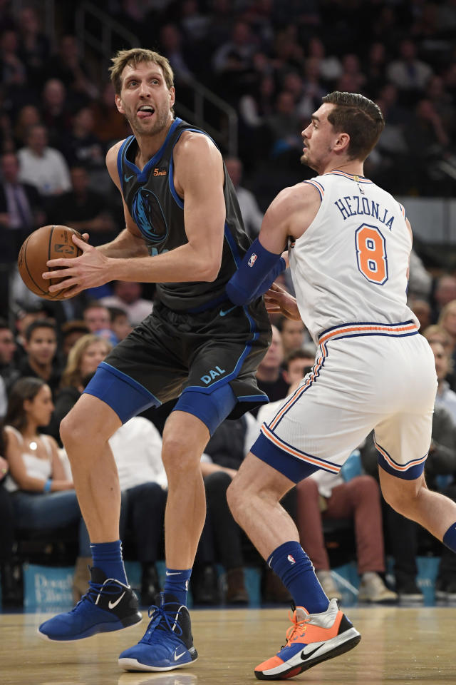 NEW YORK, NEW YORK - JANUARY 30: Dirk Nowitzki #41 of the Dallas Mavericks dribbles against Mario Hezonja #8 of the New York Knicks during the second quarter of the game at Madison Square Garden on January 30, 2019 in New York City. (Photo by Sarah Stier/Getty Images)