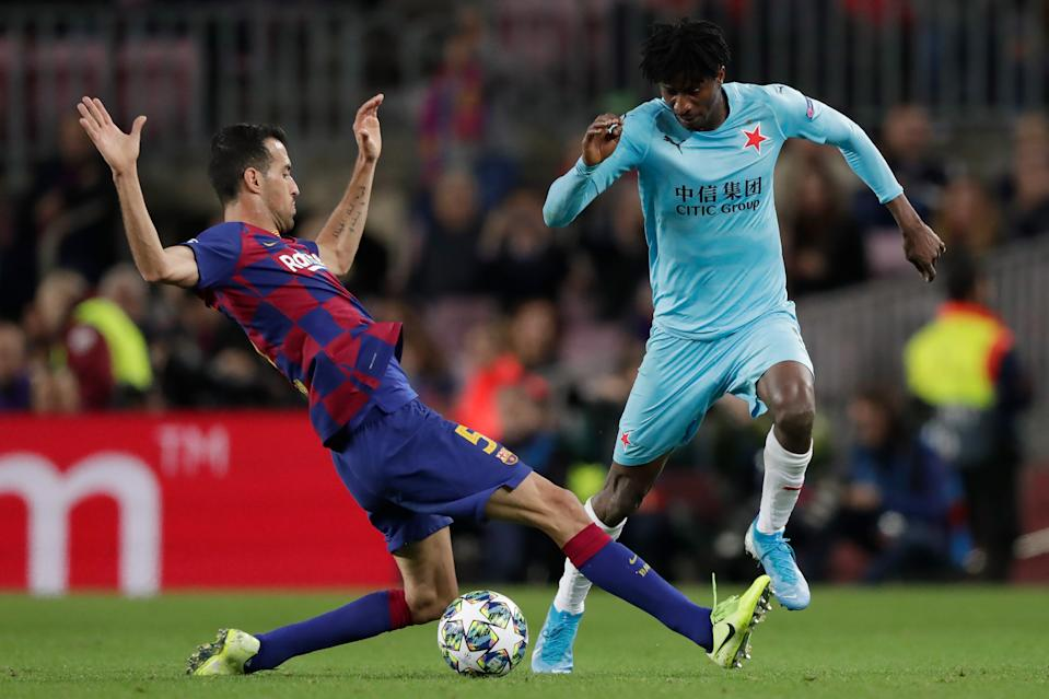 BARCELONA, SPAIN - NOVEMBER 5: (L-R) Sergio Busquets of FC Barcelona, Peter Olayinka of Slavia Praha  during the UEFA Champions League  match between FC Barcelona v Slavia Prague at the Camp Nou on November 5, 2019 in Barcelona Spain (Photo by Jeroen Meuwsen/Soccrates/Getty Images)