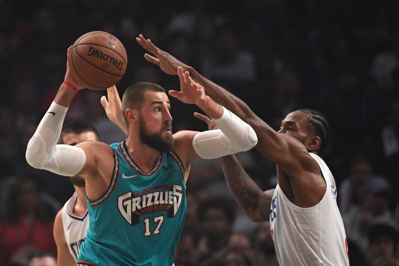 Memphis Grizzlies center Jonas Valanciunas, left, tried to get by Los Angeles Clippers forward Kawhi Leonard during the first half of an NBA basketball game Monday, Feb. 24, 2020, in Los Angeles. (AP Photo/Mark J. Terrill)