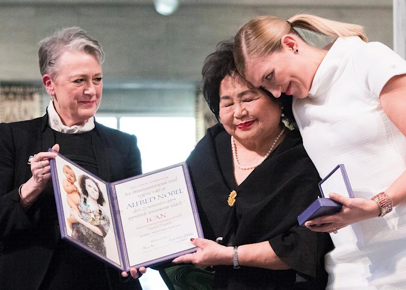 Beatrice Fihn, executivedirector of the International Campaign to Abolish Nuclear Weapons, embracesHiroshima survivor Setsuko Thurlow (center)during the Nobel Peace Prize's award ceremony on Sunday.Berit Reiss-Andersen, leader of the Nobel Committee, stands to the left.