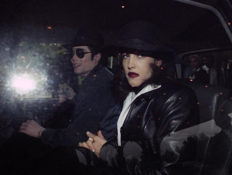 US pop star Michael Jackson and Lisa-Marie Presley leave a hotel at Euro Disneyland, Paris on Sept. 5, 1994. (AP Photo)