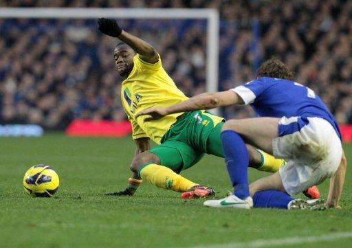 Sebastian Bassong headed in a last-minute equaliser to give Norwich a 1-1 draw at Everton