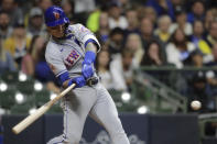 New York Mets' Javier Baez hits an RBI-single during the fourth inning of a baseball game against the Milwaukee Brewers, Saturday, Sept. 25, 2021, in Milwaukee. (AP Photo/Aaron Gash)