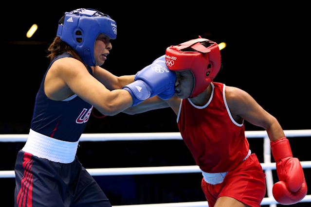 LONDON, ENGLAND - AUGUST 06: Marlen Esparza of the United States (Blue) competes against Karlha Magliocco (Red) of Venezuela during the Women's Fly (51kg) Boxing Quarterfinals on Day 10 of the London 2012 Olympic Games at ExCeL on August 6, 2012 in London, England. (Photo by Scott Heavey/Getty Images)