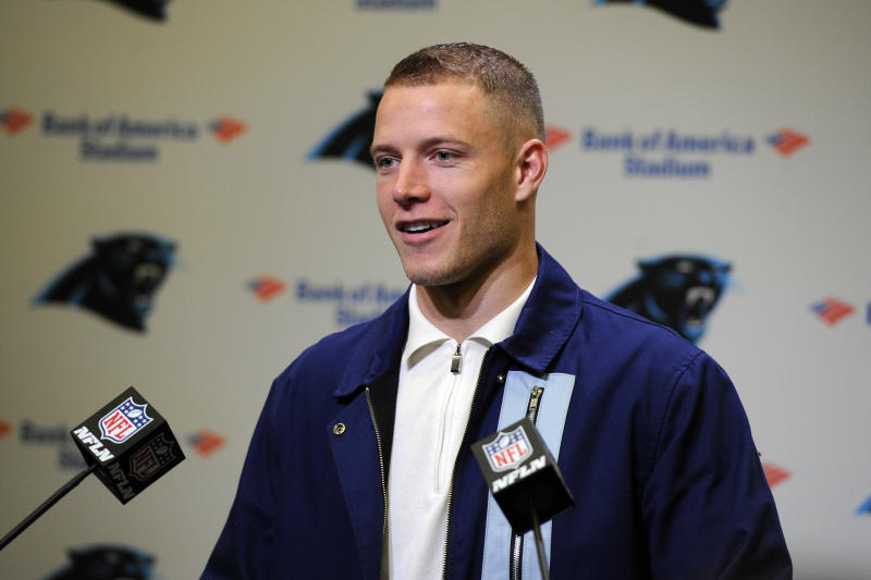 Carolina Panthers running back Christian McCaffrey (22) speaks to members of the media following an NFL football game against the New Orleans Saints in Charlotte, N.C., Sunday, Dec. 29, 2019. (AP Photo/Mike McCarn)